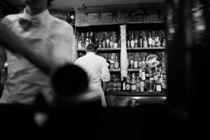 waiters in restaurant black and white